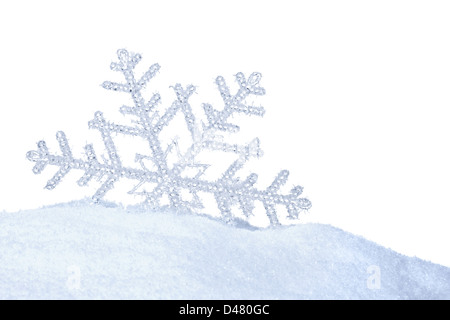 snow crystal in snow on white background - Stock Photo