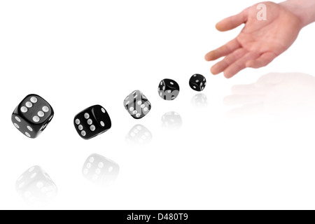 hand throwing dices on white background - Stock Photo
