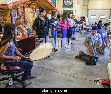 June 25, 2012 - Fairbanks, Alaska, US - Young native Alaskans rehearse tribal music and dancing in the Morris Thompson - Stock Photo