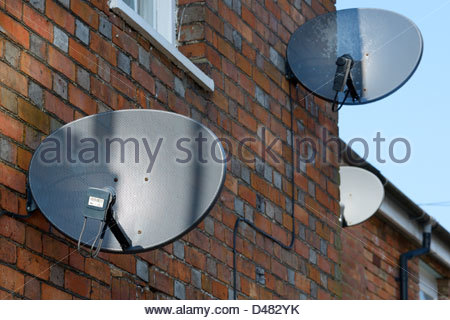 Satellite dish on terraced houses, Blandford Forum, Dorset England UK - Stock Photo