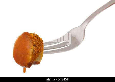 German curry sausage on fork - Stock Photo