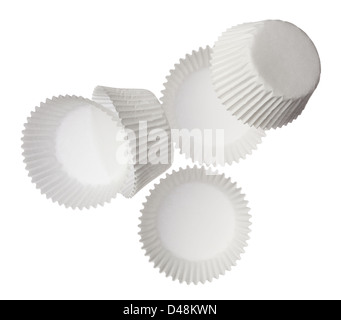 Paper muffin cups isolated on white background - Stock Photo