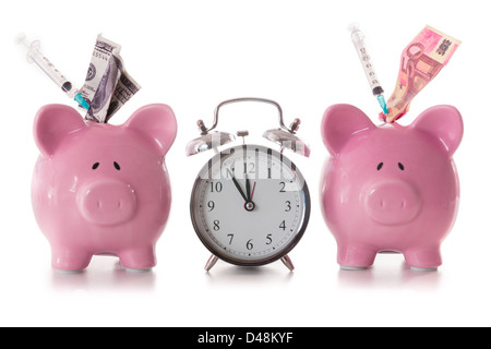 Dollar and euro notes and syringes sticking out of piggy banks with alarm clock