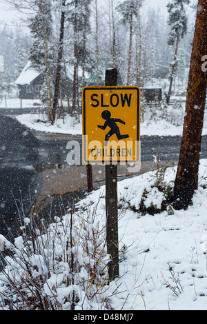 Traffic sign warning drivers to slow down and be aware of playing children - Stock Photo