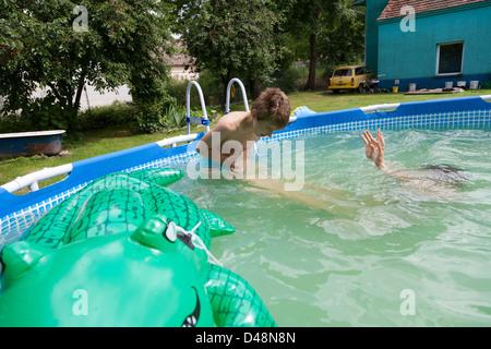 Young Boy Refreshing Bathing And Splashing In A Garden