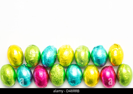 Colourful foil wrapped easter eggs - Stock Photo