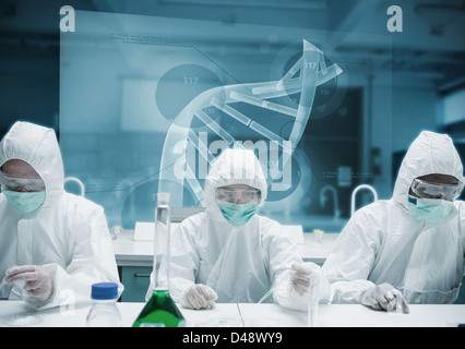 Chemists working in the lab with futuristic interface - Stock Photo