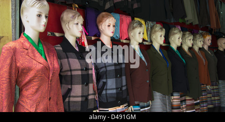Female mannequins in fashionable clothing in a row;Lhasa xizang china - Stock Photo