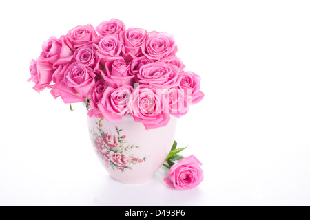 Pink roses in vase isolated on white background - Stock Photo
