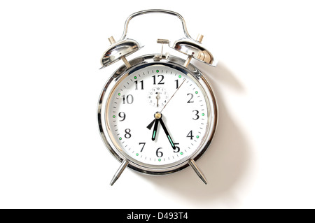 Chrome alarm clock with bells on, set just after 6-25. - Stock Photo