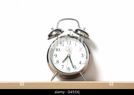Chrome alarm clock with bells on, set just after 7-25. - Stock Photo