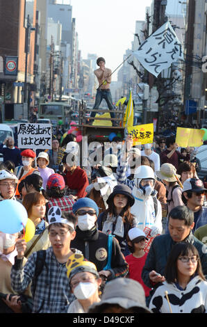Kyoto, Japan. 9th March 2013. Protesters march through Kyoto against the restart of the country's nuclear power - Stock Photo