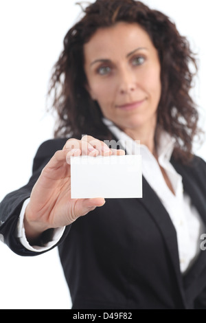 Beautiful mature businesswoman showing a blank business card on a white isolated background - Stock Photo