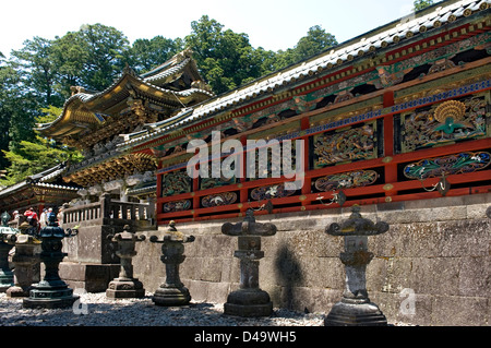 Ornate architectural relief art panels of nature scenes on the Tozai Kairo building wall at the Toshogu Shrine in - Stock Photo