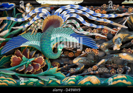 Detail of ornate architectural relief art panels of nature scenes on the Tozai Kairo building wall at the Toshogu - Stock Photo