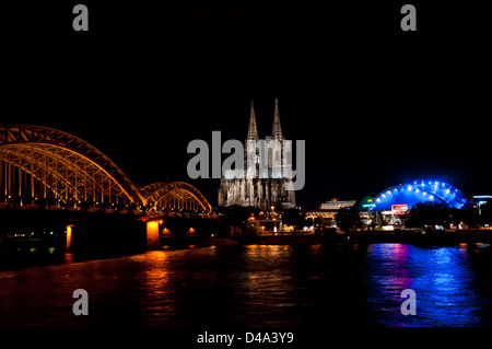 Cologne Cathedral, Hohenzollern Bridge and Musical Dome Köln at night - Stock Photo