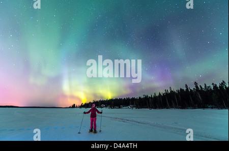 Aurora Borealis (Northern Light) on the frozen sea near Lulea Lapland Sweden Scandinavia - Stock Photo