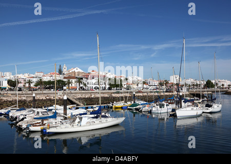 Yachts and boats in the harbor of Lagos, Algarve Portugal - Stock Photo