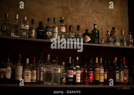 Shelves full of different alcoholic beverages bottles in the Minibar in Stuttgart, Germany at night on March 09, - Stock Photo