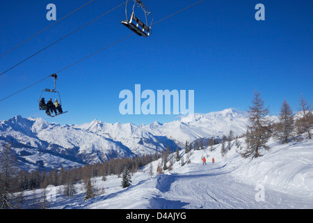 Vallandry chairlift with La Foret blue piste and Mont Blanc behind, Peisey-Vallandry, Les Arcs, Savoie, France, - Stock Photo