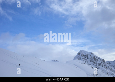 Skier skiing off-piste on Col de la Chiaupe, La Plagne, French Alps, Savoie, France, Europe - Stock Photo