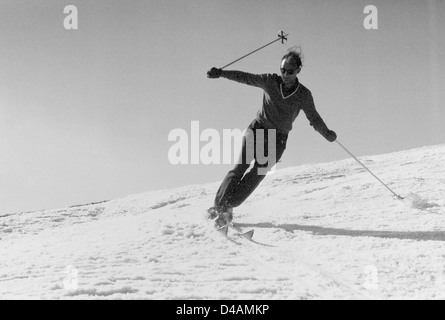 Oberwiesenthal, GDR, a man goes skiing - Stock Photo