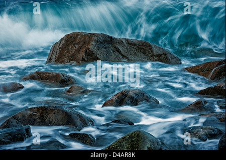 Motion of the ocean - waves breaking on rocks in Sitka Sound, Alaska, USA - Stock Photo