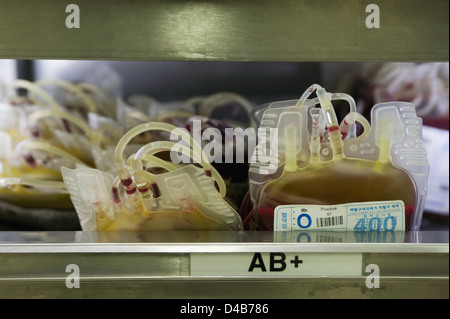 Close up of blood bags containing type AB+ (Positive) blood - Stock Photo