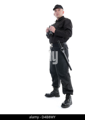 Security man wearing black uniform standing with binoculars, shot on white - Stock Photo