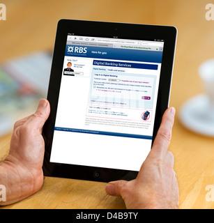 Logging onto an RBS Bank account on an iPad 4, UK - Stock Photo