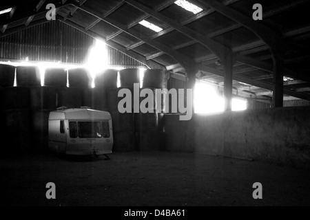 Caravan in barn - Stock Photo
