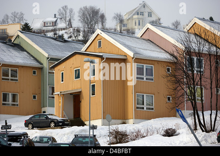 row of wooden houses built on a steep street in Tromso troms Norway europe - Stock Photo