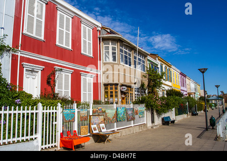 A vibrant street with a row of colourful houses in Valparaiso, Chile, UNESCO World Heritage site - Stock Photo