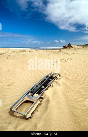 Car grill left behind on Ninety mile beach, Northland, New Zealand - Stock Photo