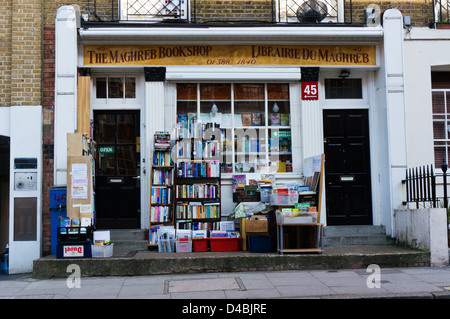 Books stacked on shelves outside The Maghreb Bookshop in Burton Street, Bloomsbury, London. - Stock Photo
