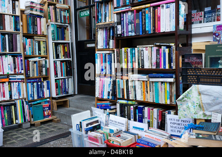 Books stacked on shelves outside a secondhand bookshop. - Stock Photo
