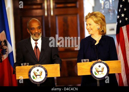 Secretary Clinton With Haitian President Rene Preval - Stock Photo