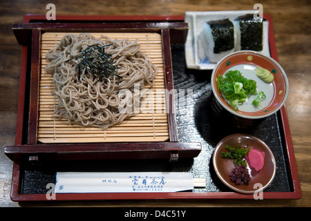 Lunch, Japanese style, includes cold soba noodles with nori, otsukemono pickles and two onigiri rice balls.