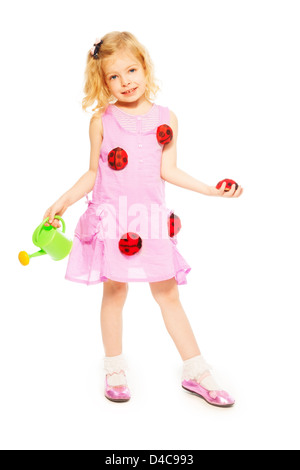 Little five years old blond girl with watering can and red ladybugs standing isolated on white - Stock Photo