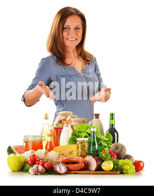 Young woman with grocery products isolated on white - Stock Photo