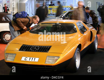 A visitor to the oldtimer show Bremen Classic Motorshow eyes a Mercedes Benz C111 dating 1969 in Bremen, Germany, - Stock Photo