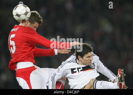 Germany's Mario Gomez (R) vies for the ball with Austria's Sebastian Proedl during the international friendly match - Stock Photo