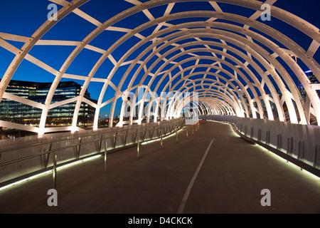 The Webb Bridge illuminated at twilight.  Melbourne, Victoria, Australia - Stock Photo