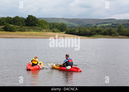 Boating in a lake in Peak District, UK - Stock Photo