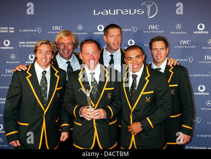 South African rugby internationals Percy Montgomery (L), Bryan Habana (2-R) and team-mates pose with their 'Laureus - Stock Photo