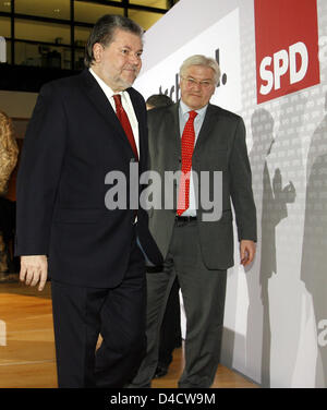 Chairman of the Social Democrats (SPD) Kurt Beck (L) and German Foreign Minister Frank-Walter Steinmeier commented - Stock Photo