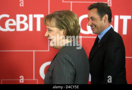 German Chancellor Angela Merkel and French President Nicolas Sarkozy at the opening ceremony of IT trade fair CeBit - Stock Photo