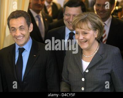 German Chancellor Angela Merkel (2-R), French President Nicolas Sarkozy (L), the President of the EU-Commission, - Stock Photo