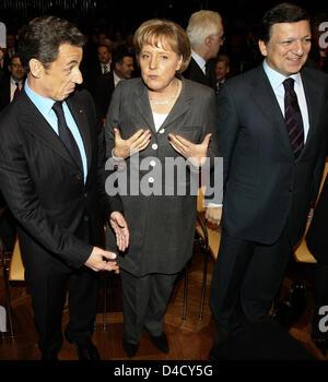 German Chancellor Angela Merkel (C), French President Nicolas Sarkozy (L) and the President of the EU-Commission, - Stock Photo