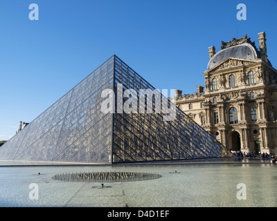 Glass pyramid in front of the Louvre, Paris, France - Stock Photo